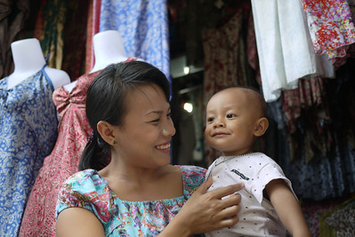 A mother and son at the Ubud market in Bali, Indonesia.