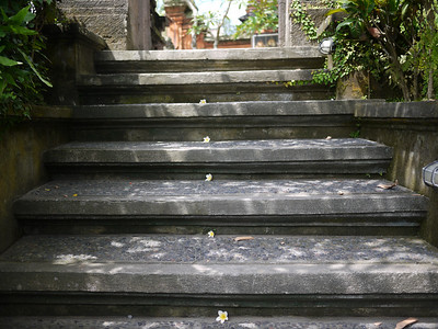 Frangipani line the steps in Bali