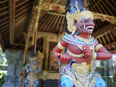 Ornate gods and statutes in a temple in Bali, Indonesia.