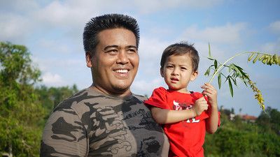 Dad and son in the rice paddies