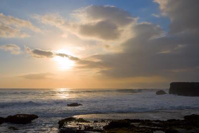Rocky ocean coast at sunset