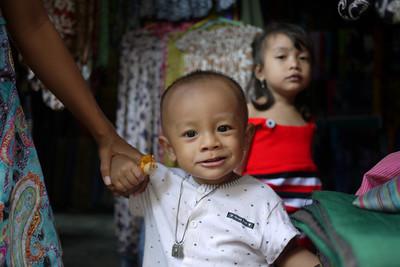 Small boy smiling at Ubud's main market, Bali Indonesia