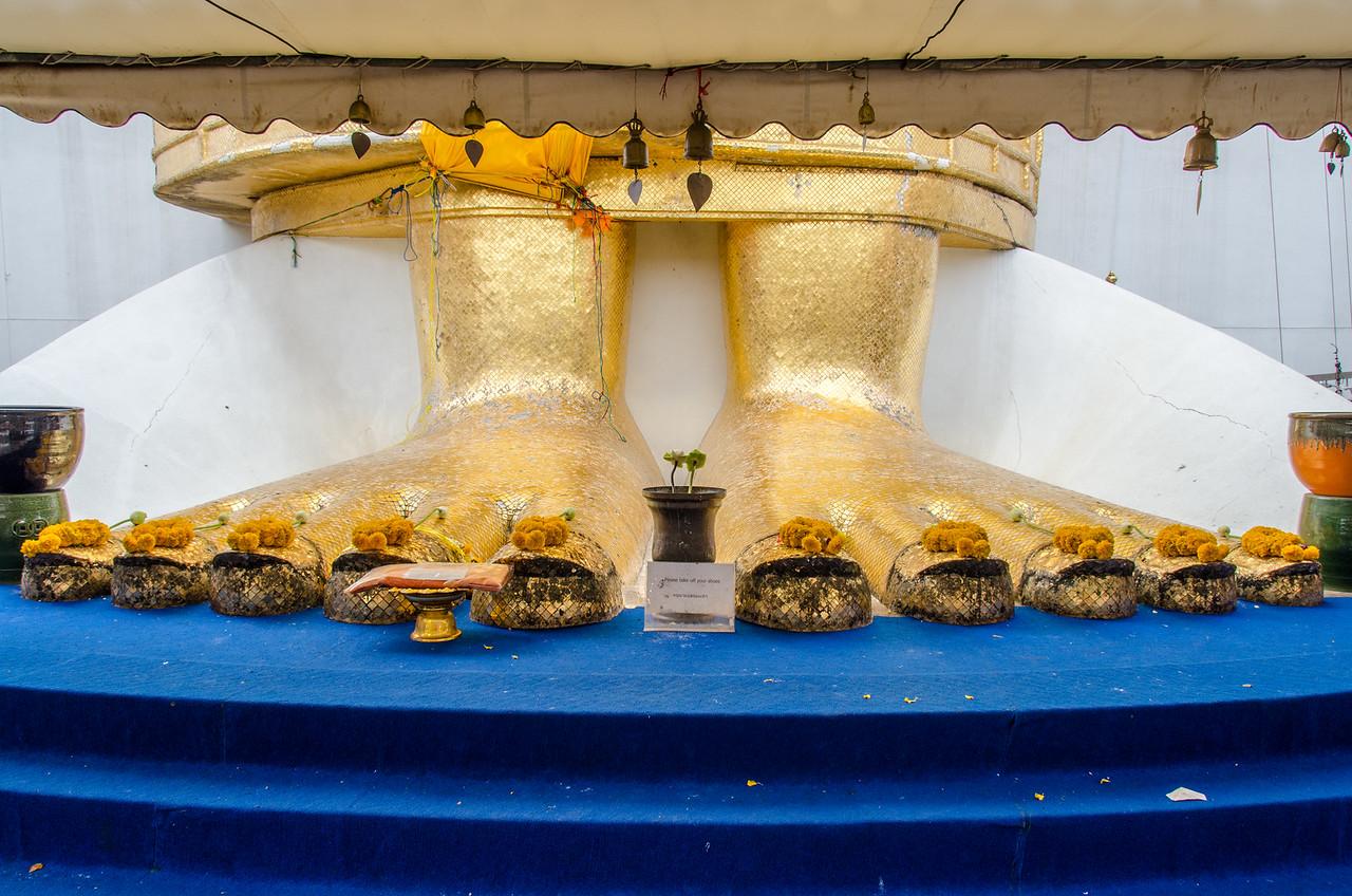 The feet of Wat Intharawihan, tallest standing buddha.