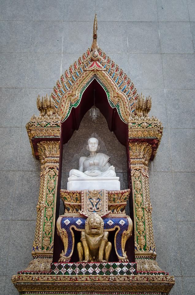 Buddha statue in a niche.