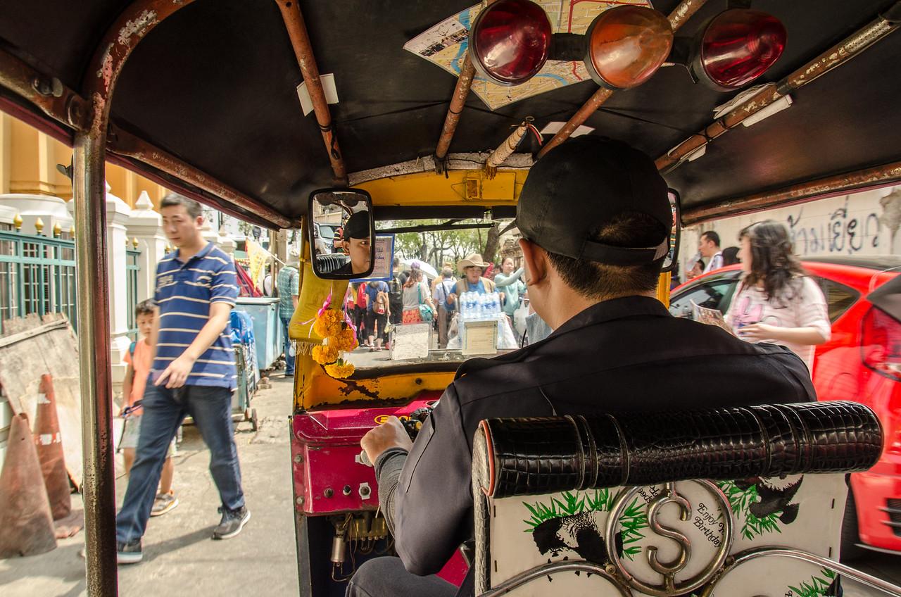 My tuk tuk driver navigates the streets of Bangkok.