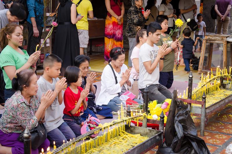 Worsshipers light candles at Doi Suthep.