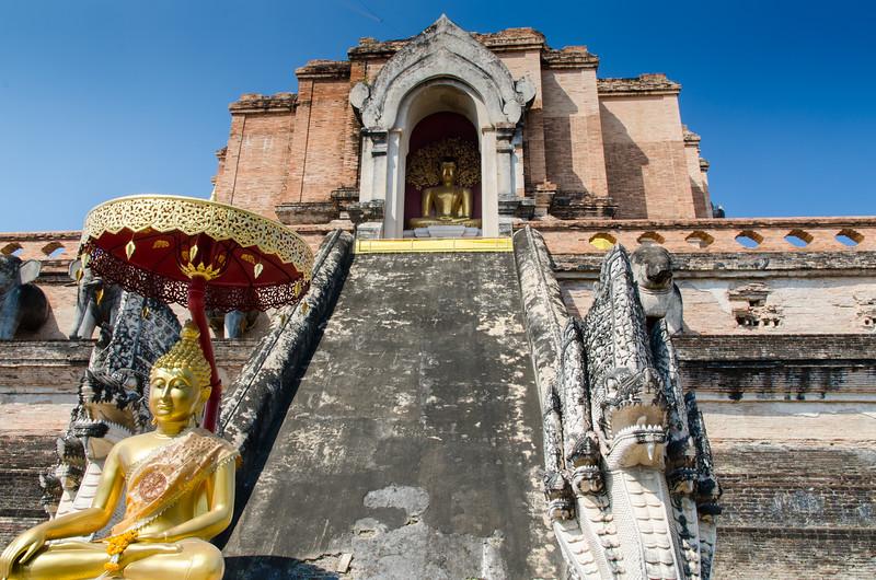 Wat Chedi Luang with buddha and umbrella.