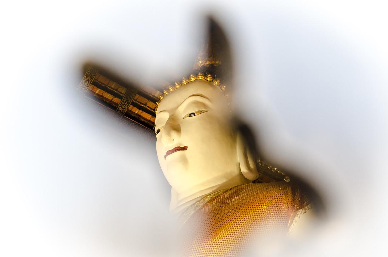Buddha viewed through an opening in  Wat Inthakhin.