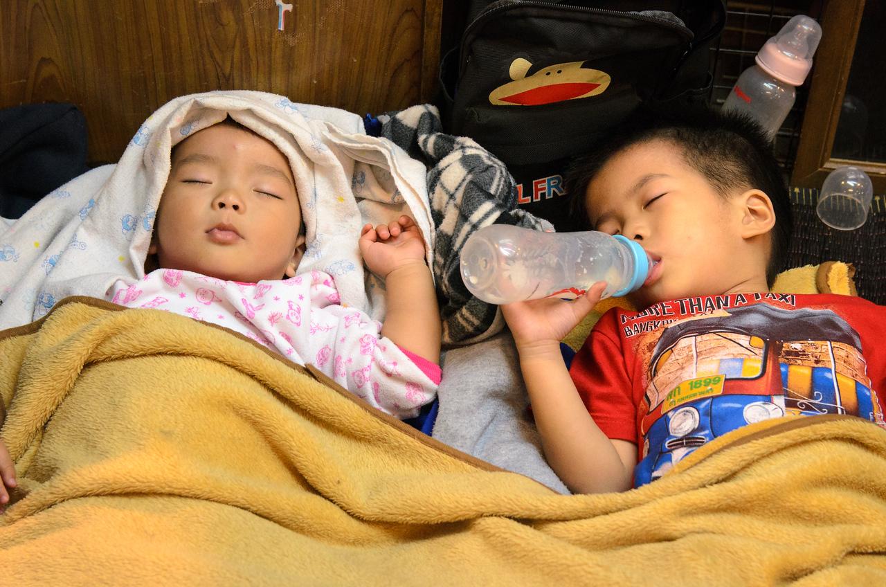 Babies sleeping in the night market.