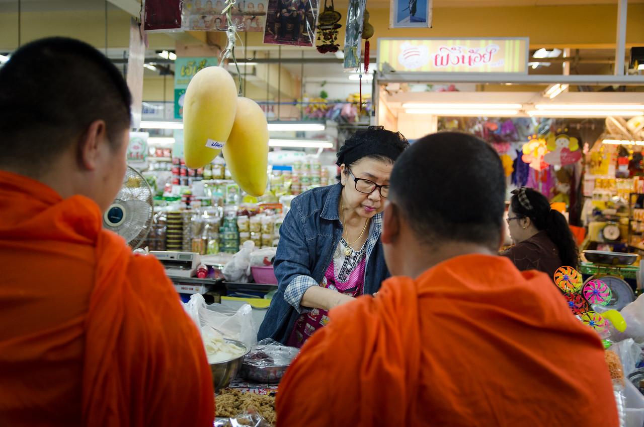 Monks shopping in Warorot Market.