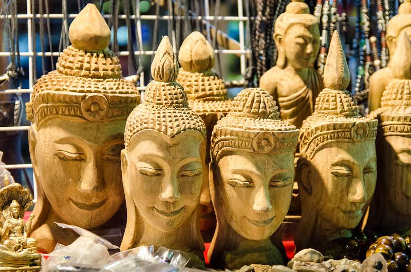 Souvenir buddha heads in the market.