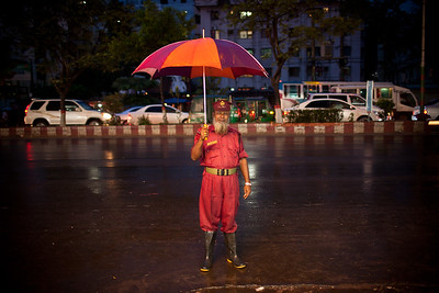 Colorful security guard in the rain in Chittagong, Bangladesh