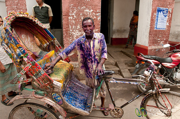 A Rickshaw Drives Through Holi Celebrations - Dhaka, Bangladesh