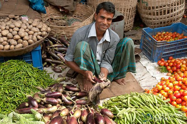 Vendor Cleans Aubergine - Srimongal, Bangladesh