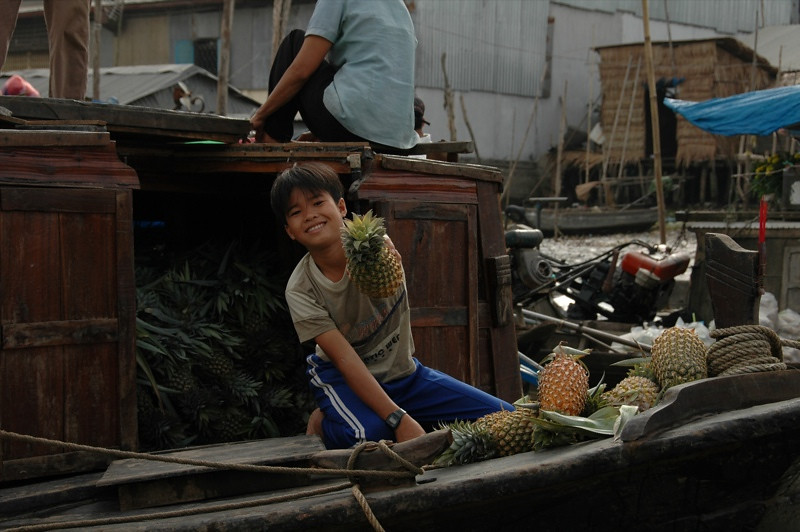 Boy Selling Pineapples - Mekong Delta, Vietnam