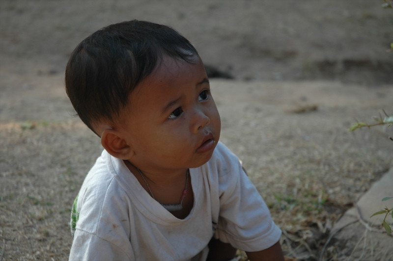 Little Boy Playing Outside Banteay Kdei - Angkor, Cambodia