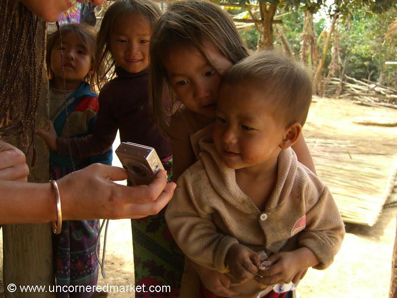 Village Boy Takes a Closer Look - Luang Prabang, Laos