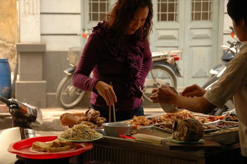 Woman at a Food Stall - Hanoi, Vietnam