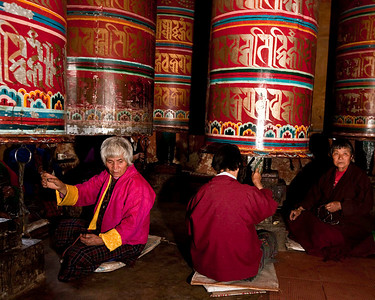 All ages particpate in turning the prayer wheels which come in every imaginable size