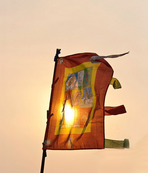 The flag at sunset at a local monastery high on a hill
