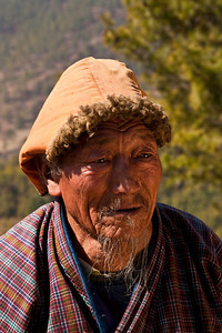 The faces of Bhutan are often aged and creased, but this old man like many others would pose for only a few moments as we were interfering with his chores.