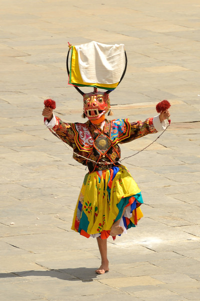 Shawo Shachi Cham: Dance of the Stag and the Hounds. Dancers wear a dog mask, stag mask and knee-length yellow skirts. The dance portrays compassion over all sentient beings as the great sage, Jetseon Milarepa, brings harmony between the stag, (the prey) and a dog, (the predator).