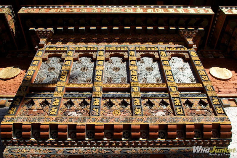 Intricate carvings and paintings on the windows of Punakha Dzong