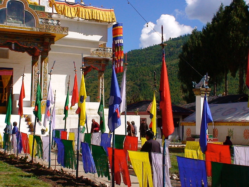 Devotees walk around the chorten clockwise