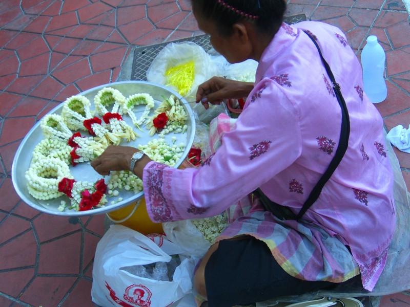 Woman Stringing Offerings - Bangkok, Thailand