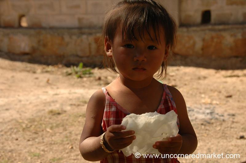 Little Burmese Girl with Puffed Rice Crisps - Kalaw, Burma