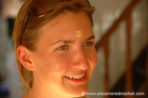 Gold Leaf on the Forehead - Mandalay, Burma