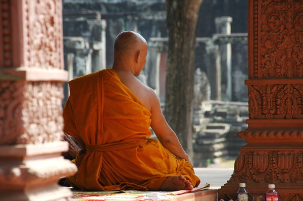 Monk Between Two Columns - Angkor, Cambodia