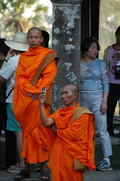 Monk Taking Photos Using A Mobile Phone - Angkor, Cambodia