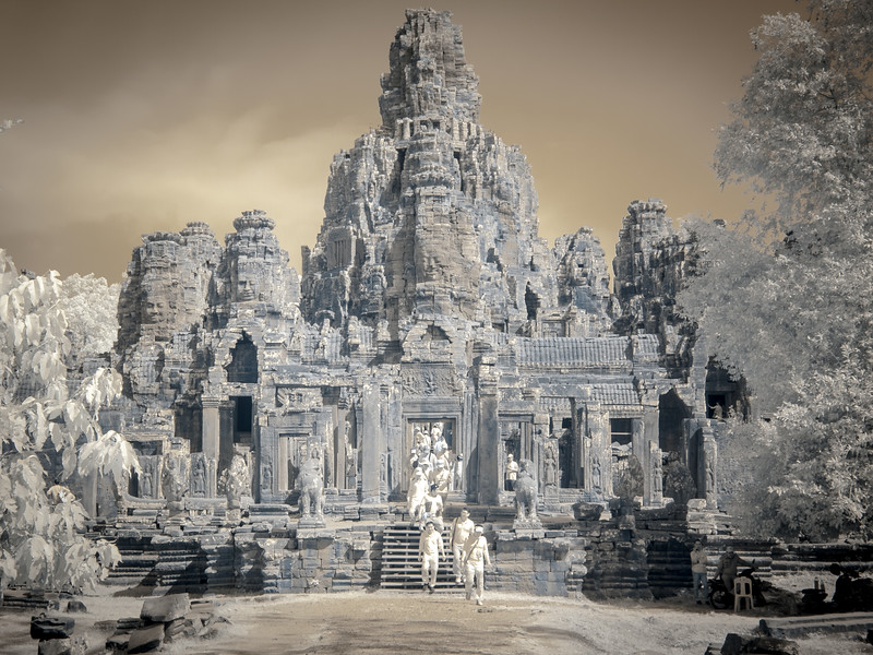 The Bayon (Khmer: ប្រាសាទបាយ័ន, Prasat Bayon) is a well-known and richly decorated Khmer temple at Angkor in Cambodia. Built in the late 12th or early 13th century as the official state temple of the Mahayana Buddhist King Jayavarman VII, the Bayon stands at the centre of Jayavarman's capital, Angkor Thom.[1][2] Following Jayavarman's death, it was modified and augmented by later Hindu and Theravada Buddhist kings in accordance with their own religious preferences.