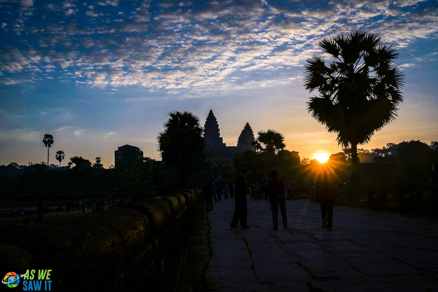 Sun peeks over the top of Angkor Wat in the early morning.