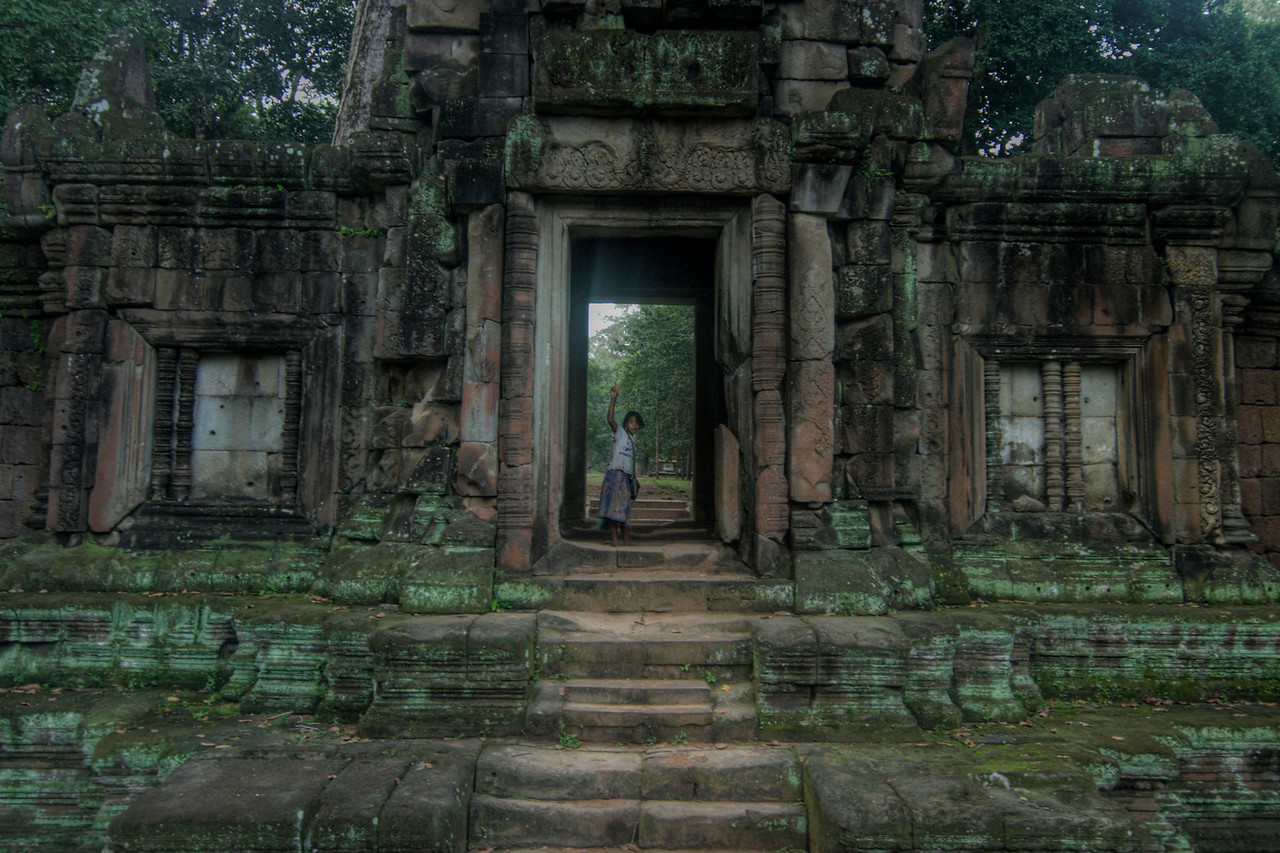 Local girl at a door in Angkor Wat ruins in Cambodia