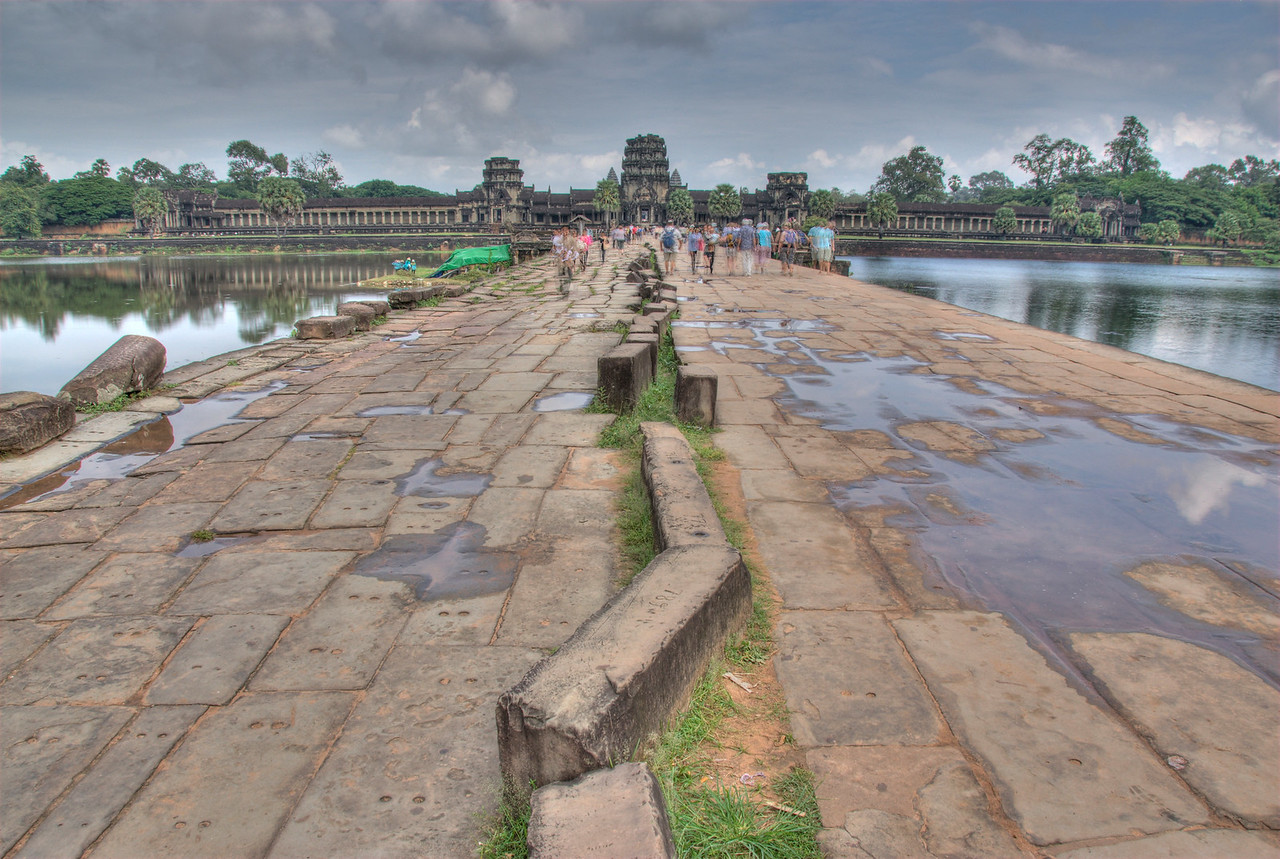 Tourists on a path to the Angkor Wat temple