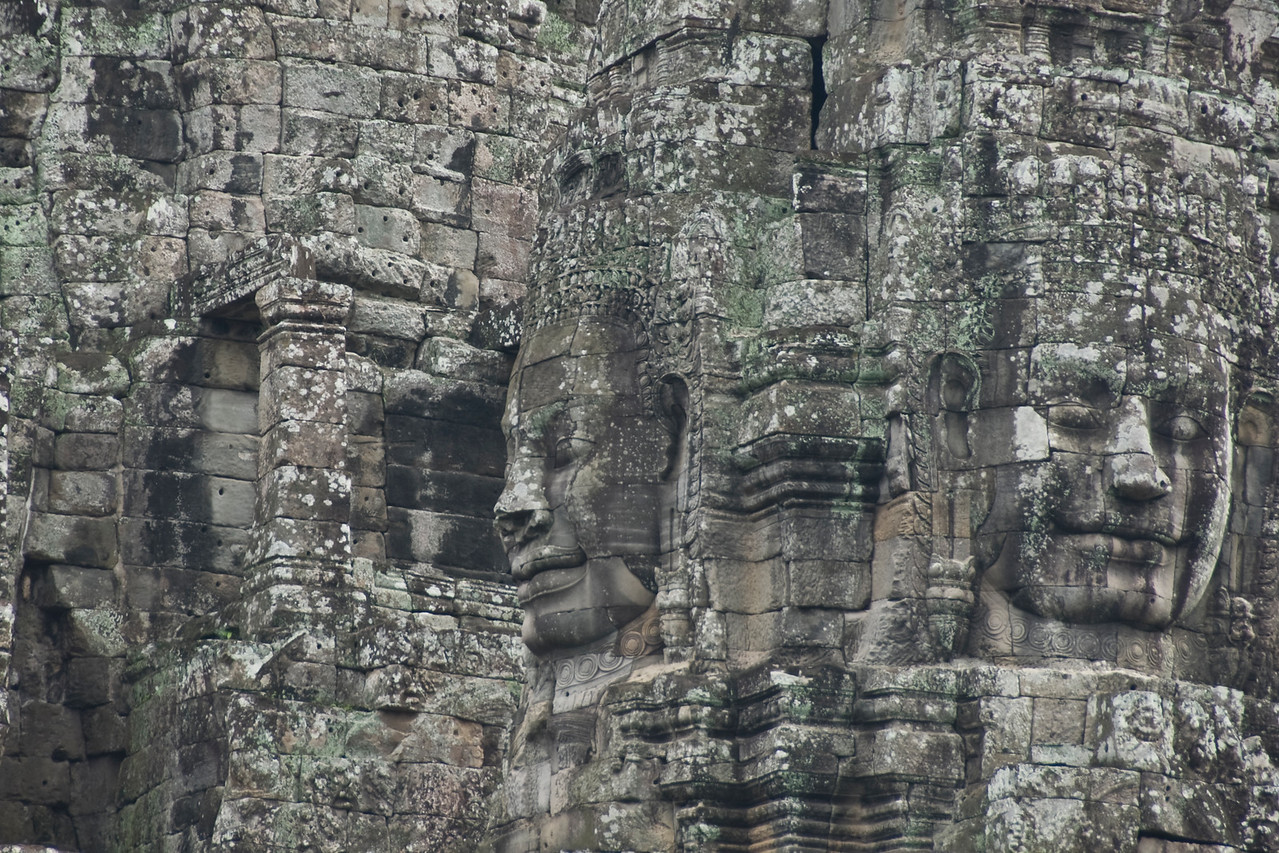 Faces carved on the walls of Bayon Temple in Cambodia