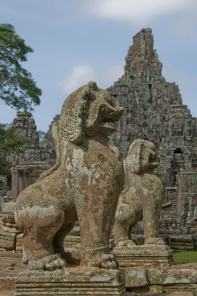 Two large statues at Bayon Temple in Cambodia
