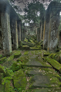 Moss covered stones and ruins at Ta Prohm in Angkor Wat
