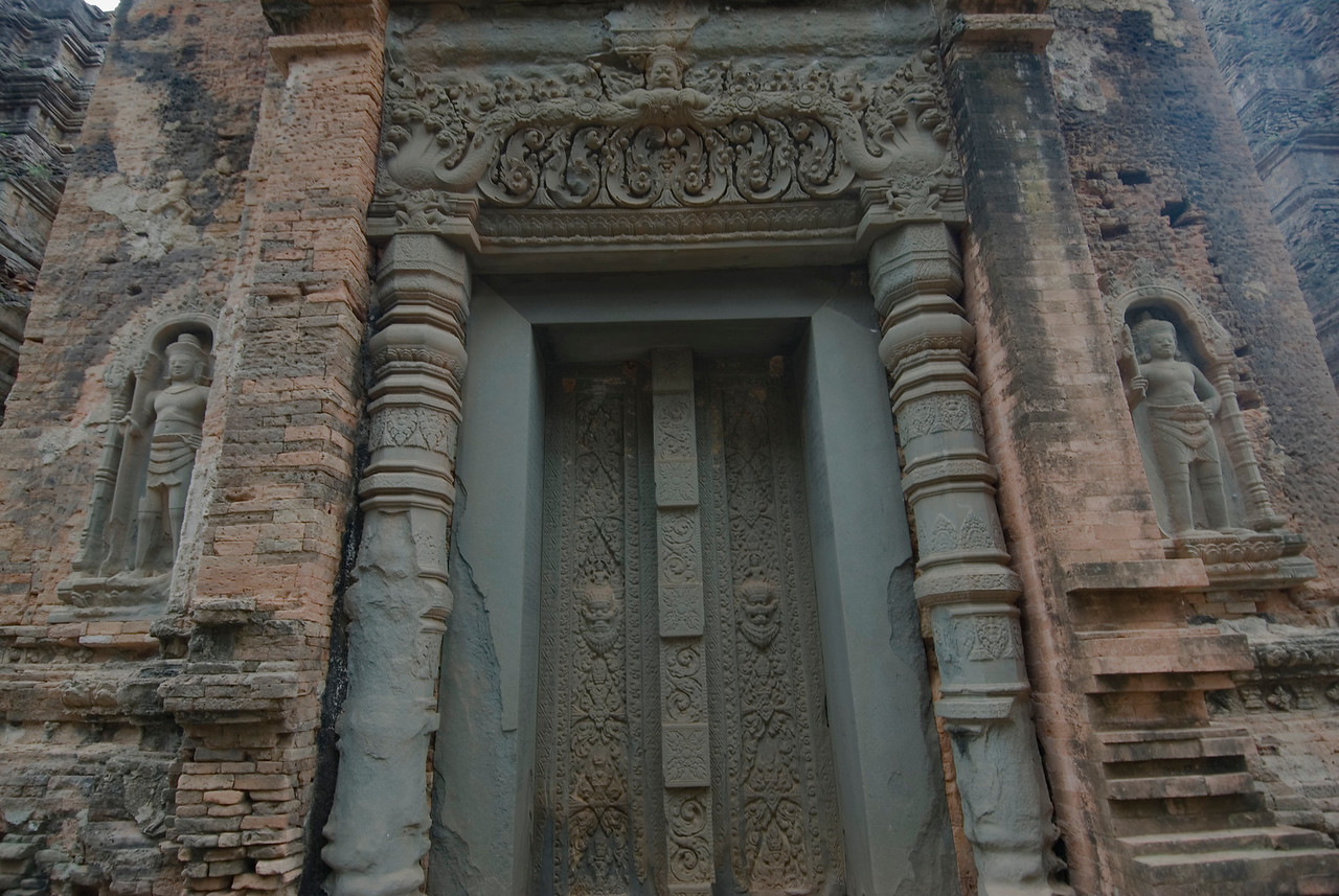 Carvings and art on doorway at Preah Ko Temple