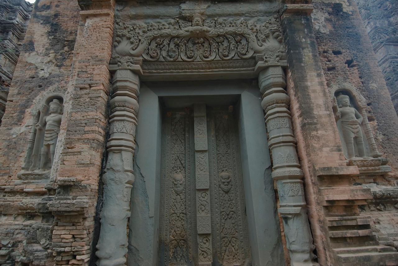 Carvings and art on doorway at Preah Ko Temple