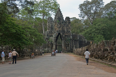 Tourists and locals along path towards the East Gate of Angkor Thom