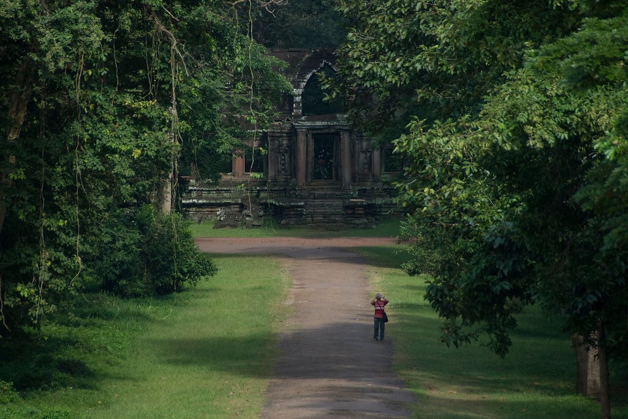 Photographer shooting behind Angkor Wat in Cambodia