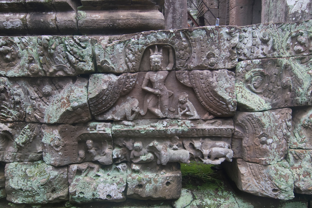Carving on the walls of Bayon Temple in Cambodia