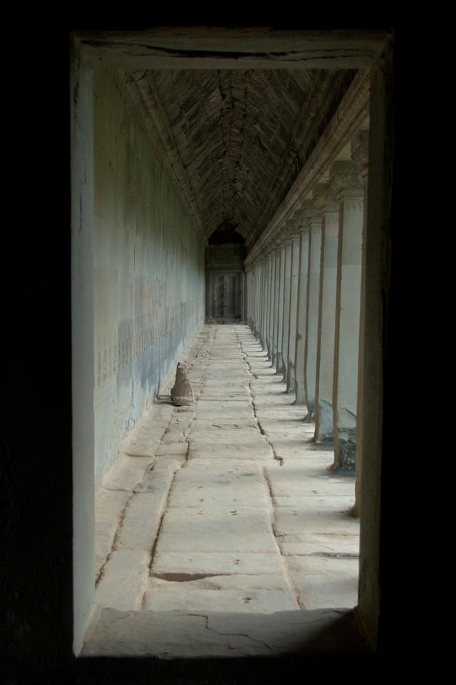 Long and empty hallway inside Angkor Wat, Cambodia