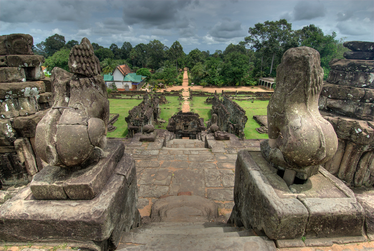 Lion statues overlooking the landscape in front of Angkor Wat