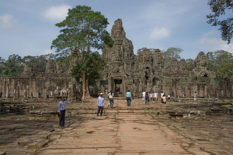 Groups of tourists in the grounds of the Angkor Wat complex