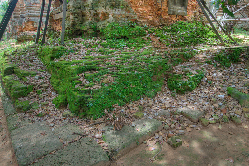 Moss covered ruins outside the Lolie Temple in Angkor Wat