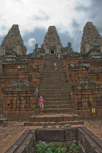 Tourists on stairs at the Angkor Wat temple